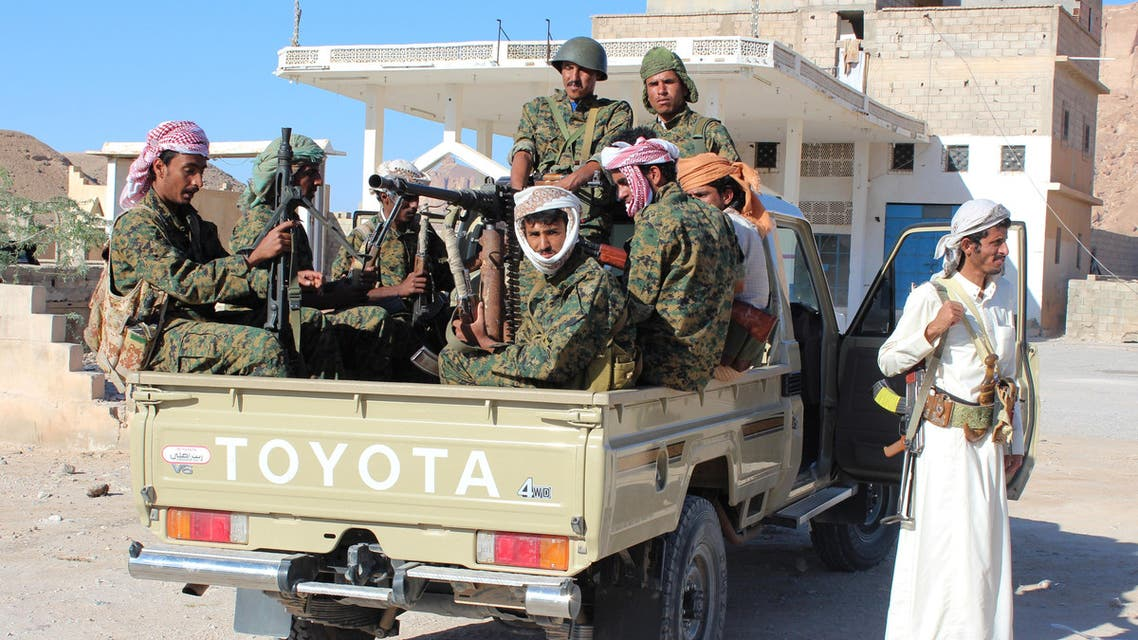 Fighters loyal to Yemen's President Abedrabbo Mansour Hadi sit in the back of a trucck as they patrol an area under their control in the Shabwa province, east of the Red Sea port of Aden, on December 21, 2015.
