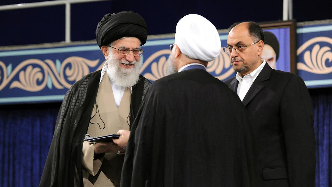A handout picture released by the official website of the Iranian supreme leader Ayatollah Ali Khamenei shows him (L) giving his official seal of approval during the swearing in ceremony of President Hassan Rouhani (R), as deputy chief of supreme leader's office Vahid Haghanian (C) looks on in Tehran on August 3, 2017. Rouhani vowed to continue his efforts to end the country's isolation as he was sworn in by supreme leader Ayatollah Ali Khamenei to serve his second term following his re-election in May.  HO / IRANIAN SUPREME LEADER'S WEBSITE / AFP