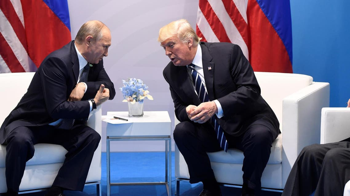 US President Donald Trump and Russia's President Vladimir Putin hold a meeting on the sidelines of the G20 Summit in Hamburg, Germany, on July 7, 2017. (AFP)