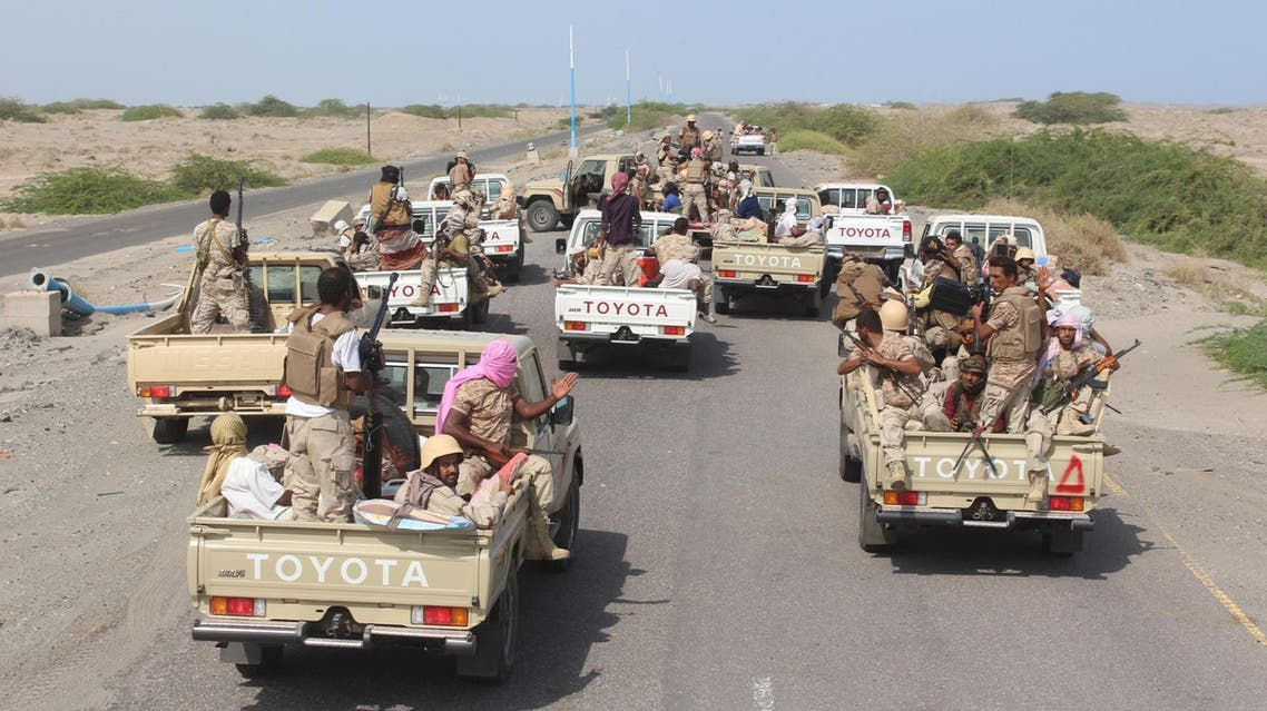 Yemeni pro-government forces ride military vehicles, as they head to Zinjibar to launch an offensive against al-Qaeda on August 14, 2016. (AFP)