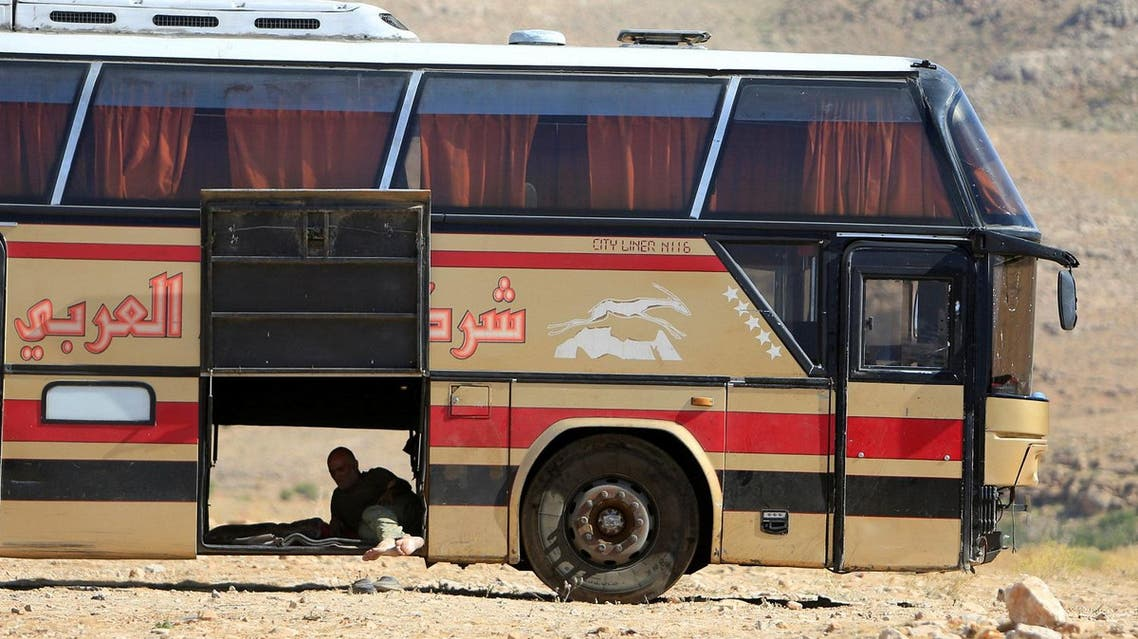 A bus driver takes a rest in Jroud Arsal, Syria-Lebanon border, on August 1, 2017. (Reuters)