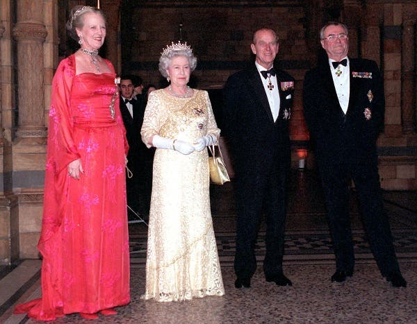 Britain's Queen ElizabethI (2nd L) and Queen Margrethe of Denmark, with their husbands the Duke of Edinburgh, (2nd R) and Prince Henrik welcome guests invited to a reception hosted by Queen Margrethe at London's Natural History Museum, February 17. (Reuters)