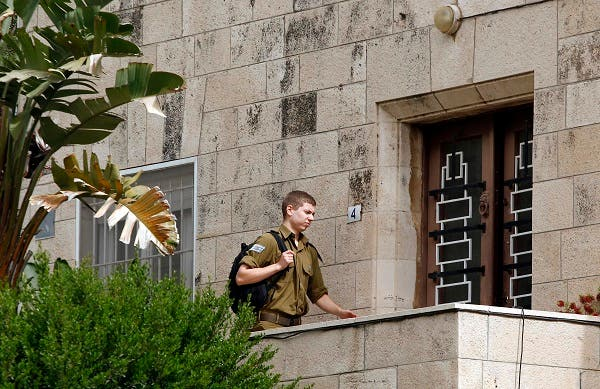The Israeli Prime Minister's 19-year-old son, Yair Netanyahu, enters the house of his grandfather, Benzion Netanyahu, on April 30, 2012 in Jerusalem. (AFP)