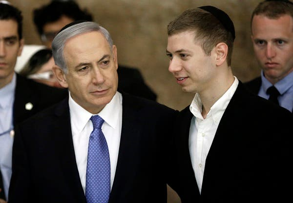 Israeli Prime Minister Benjamin Netanyahu (L) and his son Yair visit, on March 18, 2015, the Wailing Wall in Jerusalem following his party Likud's victory in Israel's general election. (AFP)