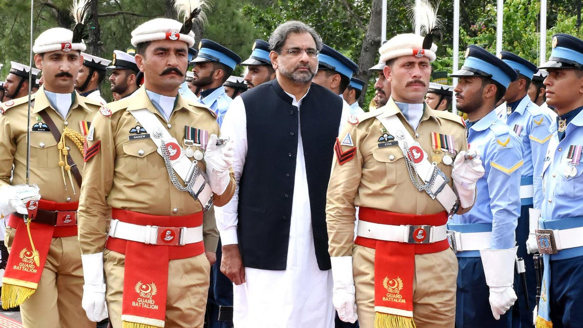 In this handout photograph released by Pakistan's Press Information Department (PID) on August 3, 2017, Pakistan's Prime Minister Shahid Khaqan Abbasi (C) reviews the honour guard during a welcome ceremony at the Prime Minister House in Islamabad. Pakistan's parliament elected ruling party loyalist Shahid Khaqan Abbasi as prime minister on August 1, after Nawaz Sharif's ouster by the Supreme Court following a corruption probe.  Abbasi is seen as a placeholder for Sharif's designated successor, his younger brother Shahbaz, who must first be elected to the 342-member National Assembly before taking the top office. HANDOUT / PID / AFP