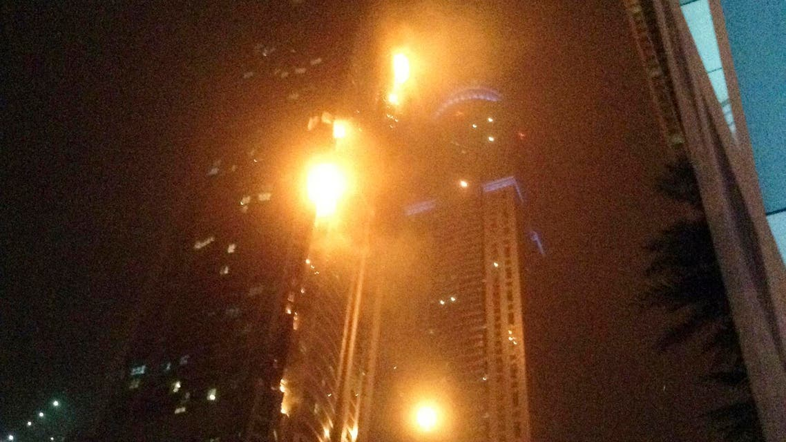 """A fire blazes at """"The Torch"""", a residential high-rise tower, in Dubai February 21, 2015. reuters"""