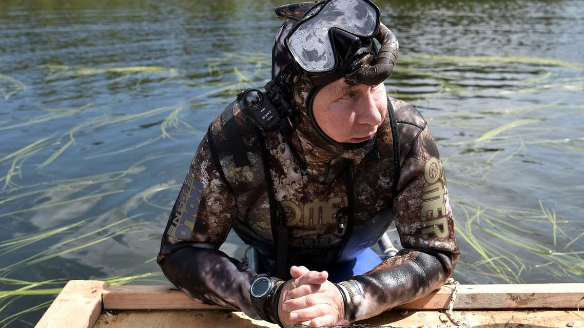 Russian President Vladimir Putin rests after swimming during the hunting and fishing trip which took place in the republic of Tyva in southern Siberia, Russia. (Reuters)