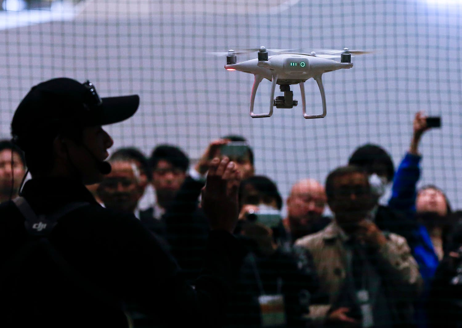 Chinese consumer-drone maker DJI's Phantom 4 flies during a demonstration at Japan Drone expo in Chiba, near Tokyo. (AP)