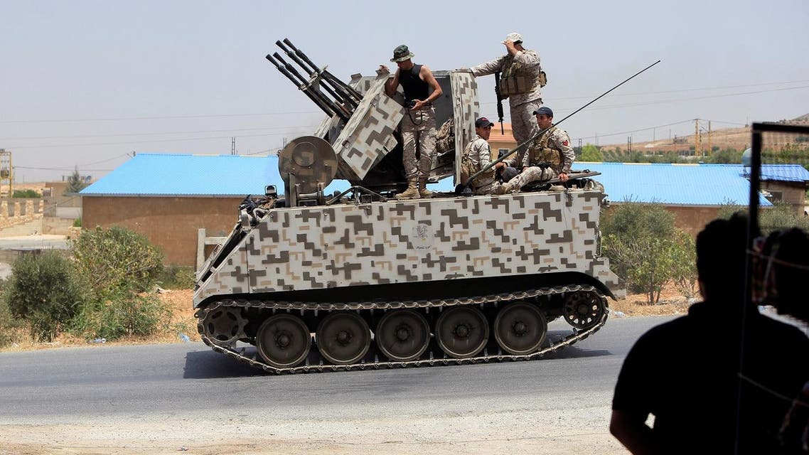 Lebanese army soldiers ride on a military tank in Labwe, at the entrance of the border town of Arsal, in Bekaa Valley, Lebanon July 27, 2017. (Reuters)