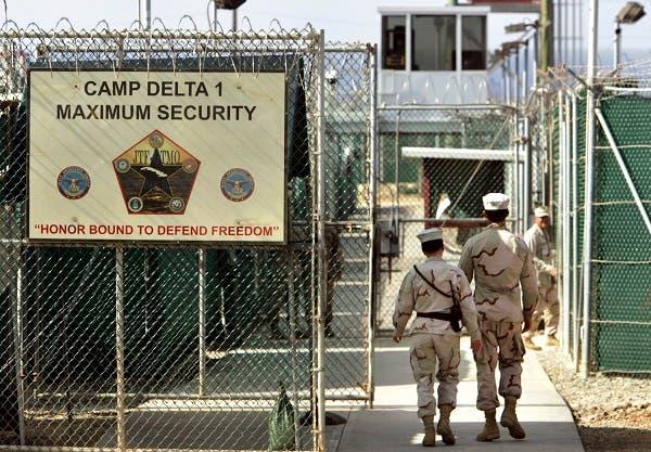 U.S. military guards walk within Camp Delta military-run prison, at the Guantanamo Bay U.S. Naval Base, Cuba. (AP)