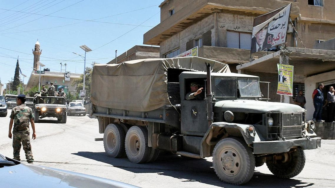A convoy of Lebanese army soldiers drives at the entrance of the border town of Arsal, in eastern Bekaa Valley, Lebanon June 30, 2017.(Reuters)