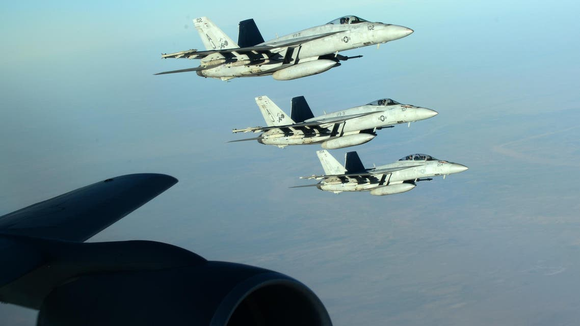 """This US Air Forces Central Command photo released by the Defense Video & Imagery Distribution System (DVIDS) shows a formation of US Navy F-18E Super Hornets in flight after receiving fuel from a KC-135 Stratotanker over northern Iraq, on September 23, 2014. These aircraft were part of a large coalition strike package that was the first to strike ISIL targets in Syria. AFP PHOTO / US Air Force / Staff Sgt. Shawn Nickel == RESTRICTED TO EDITORIAL USE / MANDATORY CREDIT: """"AFP PHOTO / US Air Forces Central Command via DVIDS / Staff Sgt. Shawn Nickel"""" / NO SALES / NO MARKETING / NO ADVERTISING CAMPAIGNS / DISTRIBUTED AS A SERVICE TO CLIENTS == Staff Sgt. Shawn Nickel / US Air Forces Central Command / AFP"""