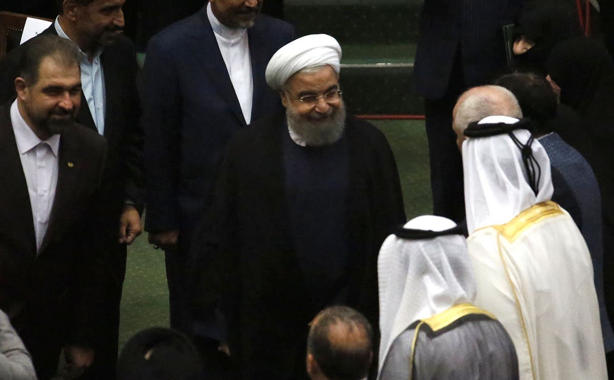 Iran's President Hassan Rouhani (C) greets visitors after being sworn in before parliament in Tehran. (AFP)