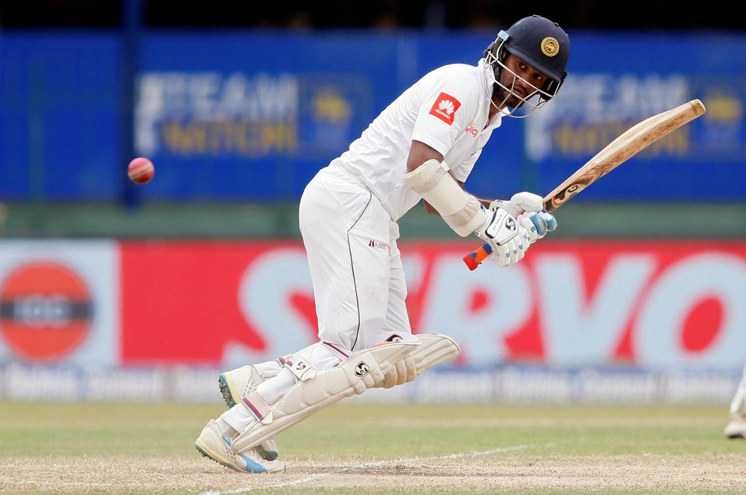 Sri Lanka's Dimuth Karunaratne hits a boundary action in the second Test match against India in Colombo. (Reuters)