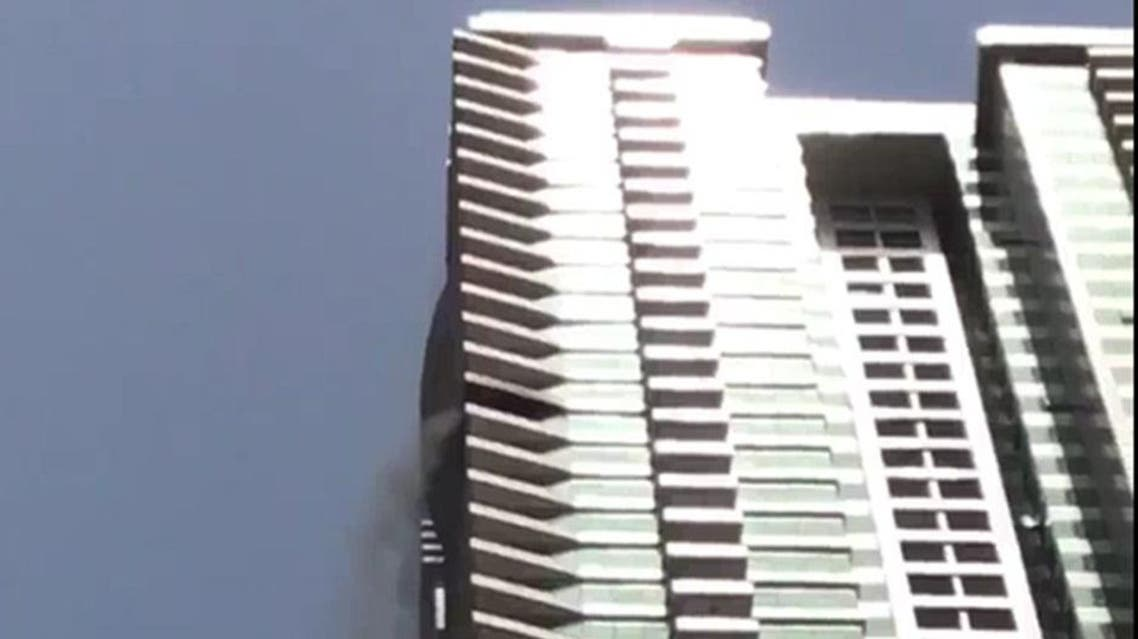 Firefighters say the Tiger Tower blaze began from clothing left on a balcony. (Twitter)