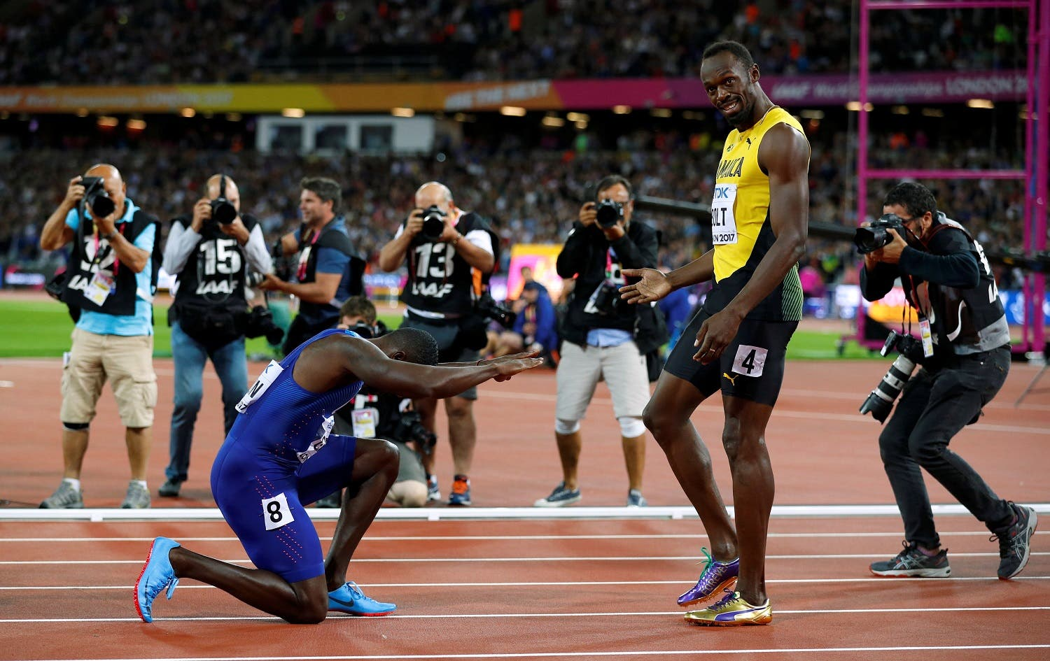 Usain Bolt of Jamaica with Justin Gatlin of the US after the final in World Athletics Championships Men's 100 meters final in London on August 5, 2017. (Reuters)