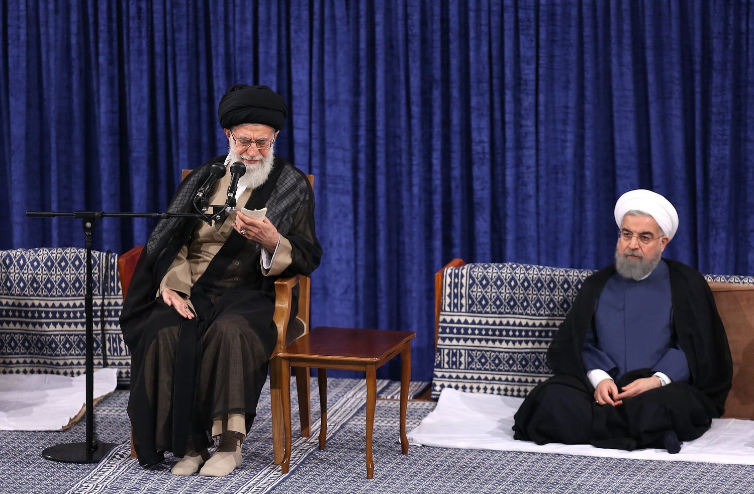 Supreme Leader Ayatollah Ali Khamenei, left, speaks in the official endorsement ceremony of President Hassan Rouhani, right, in Tehran, on Aug. 3, 2017. (AP)