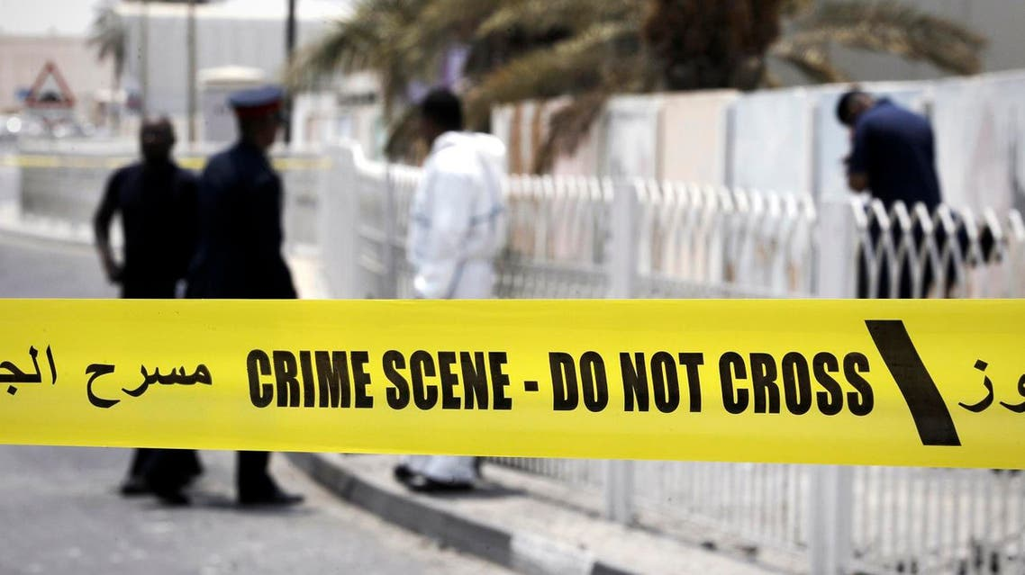 Bahraini forensic police inspect the site of a bomb blast in the village of Sitra, south of Manama, on July 28, 2015. The blast killed two Bahraini policemen and wounded six others in an area often shaken by clashes between security forces and Shiite Muslim protesters, according to the interior ministry. Bahrain has seen frequent unrest since the minority Sunni rulers of the small Gulf kingdom crushed a Shiite-led uprising four years ago. AFP PHOTO / MOHAMMED AL-SHAIKH