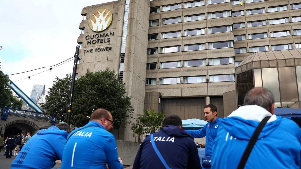 Members of Italy's athletics squad eat outside the Tower Hotel in London. (Reuters)