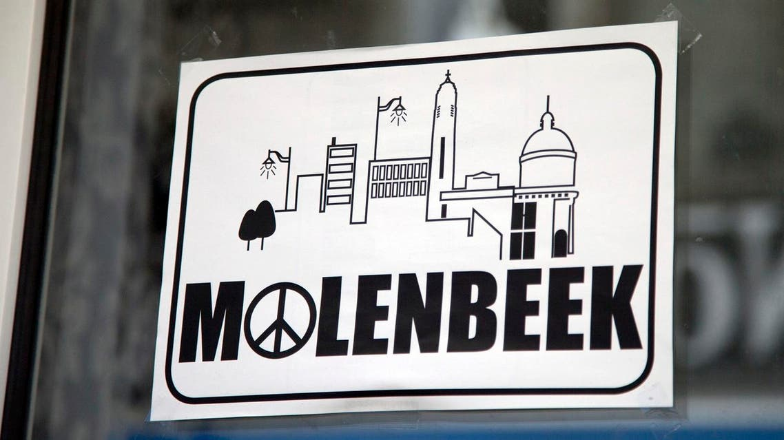 In this Nov. 18, 2015 file photo, a sign in a shop window reads Molenbeek, with a peace sign, on the main shopping street of Molenbeek, Belgium. (AP)