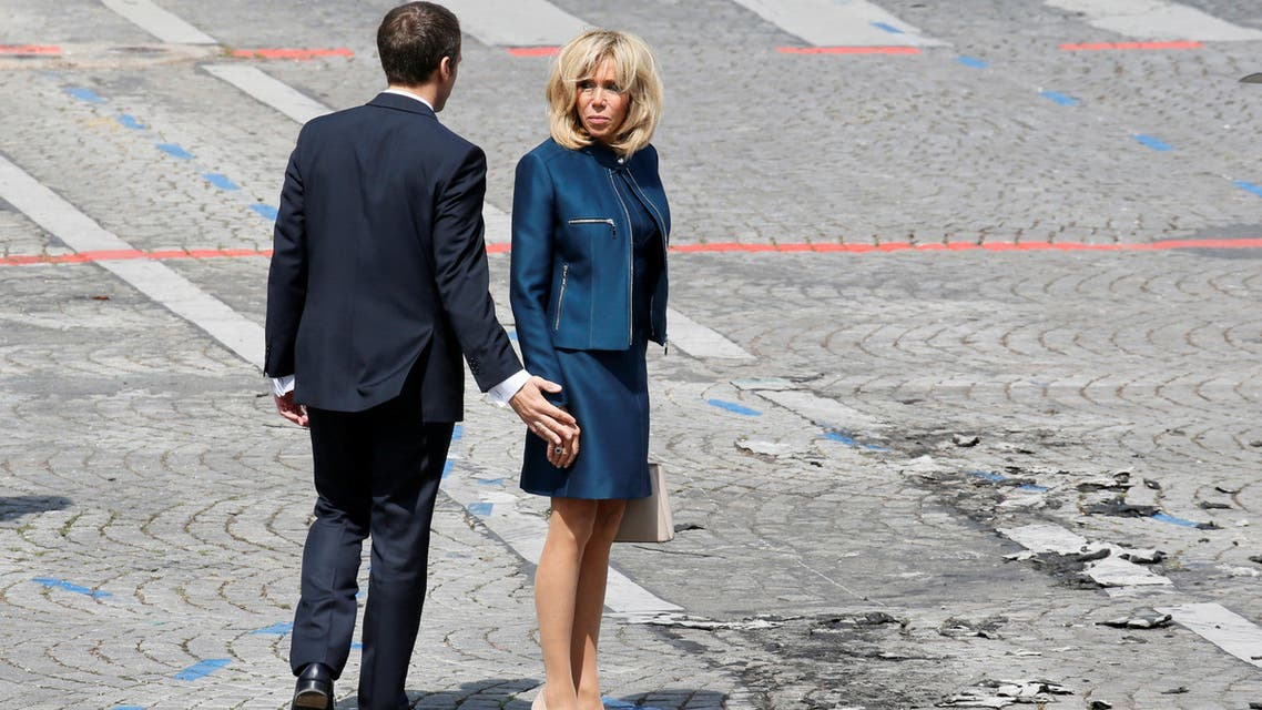 French President Emmanuel Macron and his wife Brigitte Macron leave after the traditional Bastille Day military parade on the Champs-Elysees in Paris, France, July 14, 2017. REUTERS/Gonzalo Fuentes