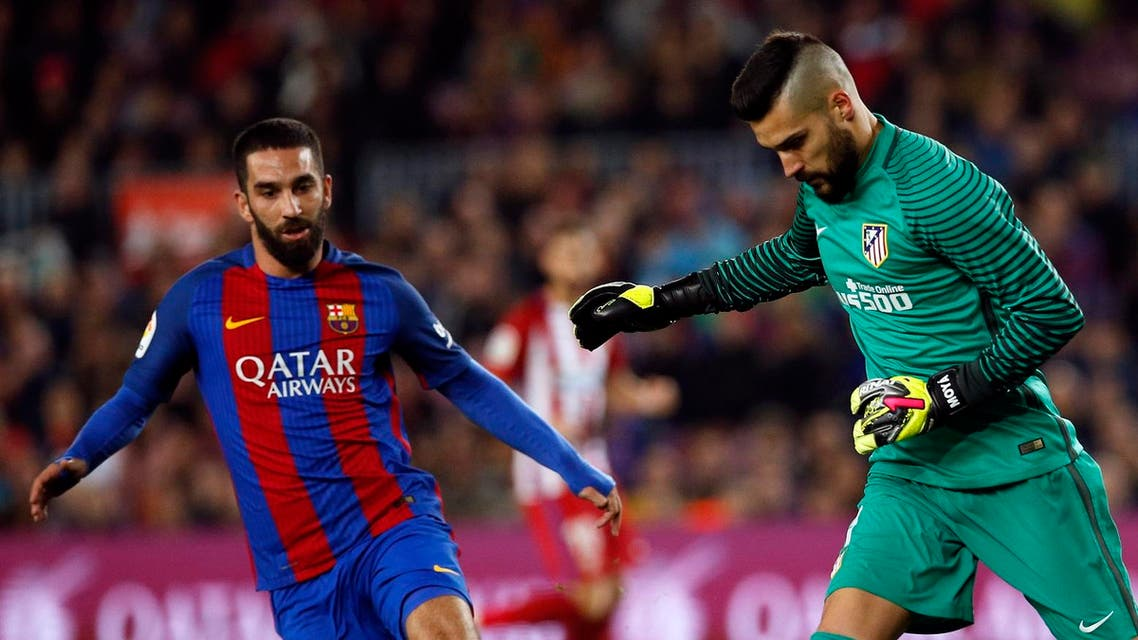 Barcelona forward Arda Turan (left) is looking for more playtime this season and a return to Galatasaray may be possible. (Reuters)