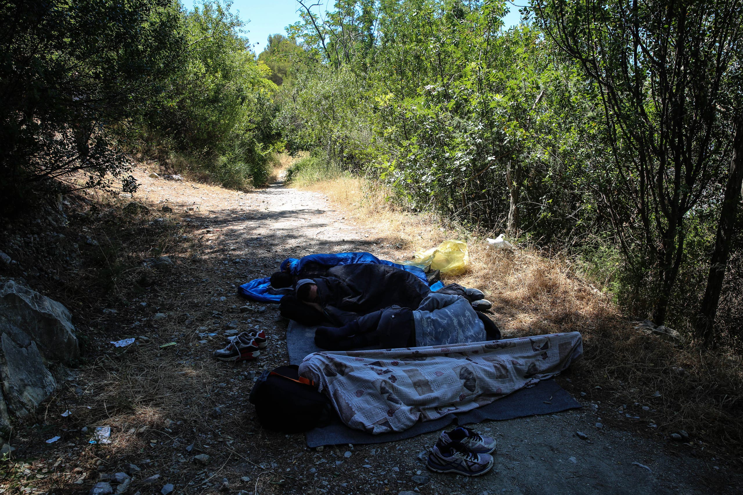 Most of the migrants must try several times before they succeed to get to France, as they are pushed back by French police. They sleep at the foot of the mountains, on the Italian side, waiting for nightfall before they try again. (Mohammad Ghannam,MSF)