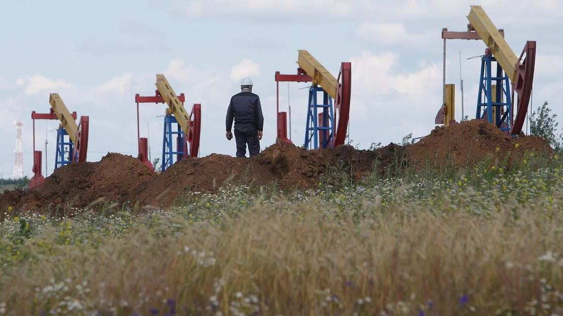 A worker stands in front of pump jacks at the Ashalchinskoye oil field owned by Russia's oil producer Tatneft near Almetyevsk, in the Republic of Tatarstan, Russia, July 27, 2017. (Reuters)