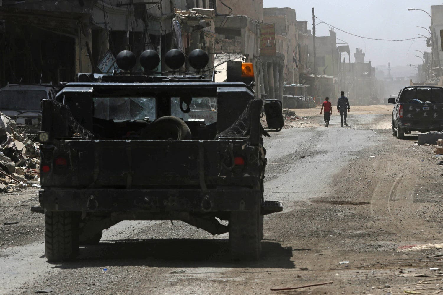 Iraqi forces patrol the old city in western Mosul on July 30, 2017. AFP