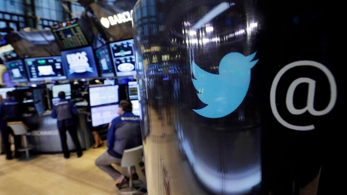 In this file photo, the Twitter logo appears on a phone post on the floor of the New York Stock Exchange. (AP /Richard Drew)