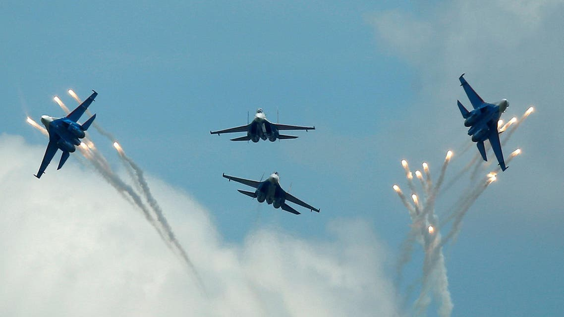 FILE PHOTO: Sukhoi Su-27 jet fighters of the Russkiye Vityazi (Russian Knights) aerobatic team fly in formation during the International Army Games 2016, in Dubrovichi outside Ryazan, Russia, August 5, 2016. REUTERS/Maxim Shemetov/File Photo