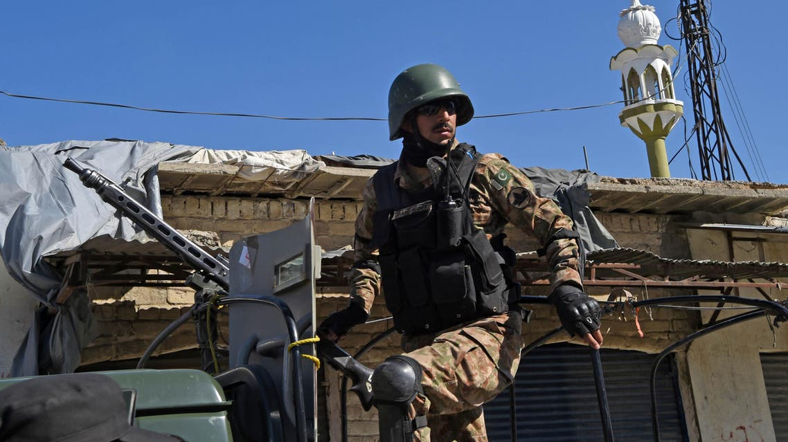 A Pakistani soldier stands guard on an army vehicle at the site of a court complex after multiple Taliban suicide bombings in the Tangi area of Charsadda district on February 21, 2017. At least five people were killed when multiple Taliban suicide bombers attacked a court complex in Pakistan on February 21, officials said, the latest in a series of assaults which have raised fears militants are regrouping. ABDUL MAJEED / AFP