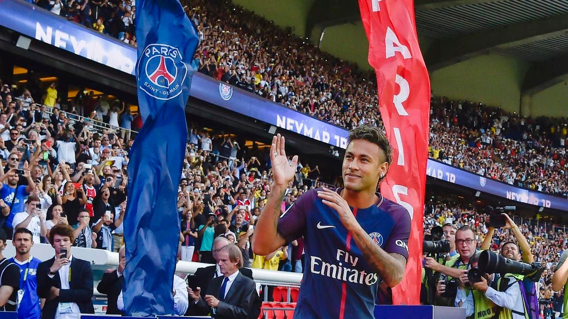 Paris Saint-Germain's Brazilian forward Neymar gestures as his arrives during his presentation to the fans at the Parc des Princes stadium in Paris on August 5, 2017. Brazil superstar Neymar will watch from the stands as Paris Saint-Germain open their season on August 5, 2017, but the French club have already clawed back around a million euros on their world record investment. Neymar, who signed from Barcelona for a mind-boggling 222 million euros ($264 million), is presented to the PSG support prior to his new team's first game of the Ligue 1 campaign against promoted Amiens. AFP