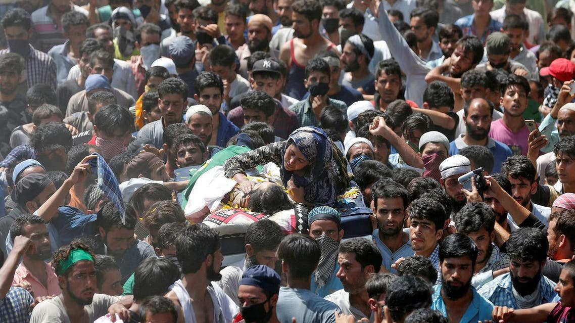 A relative hugs the body of Abid Hamid Mir, a suspected militant, killed during a gunbattle with Indian security forces at Amargarh in Baramulla district, on August 5, 2017. (Reuters)