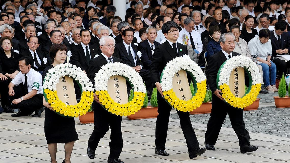Nagasaki's Mayor Tomihisa Taue (2nd R) and other representavies carry wreaths for atomic bomb victims during a ceremony at the Peace Memorial Park in Nagasaki, western Japan, on August 9, 2017. (AFP)