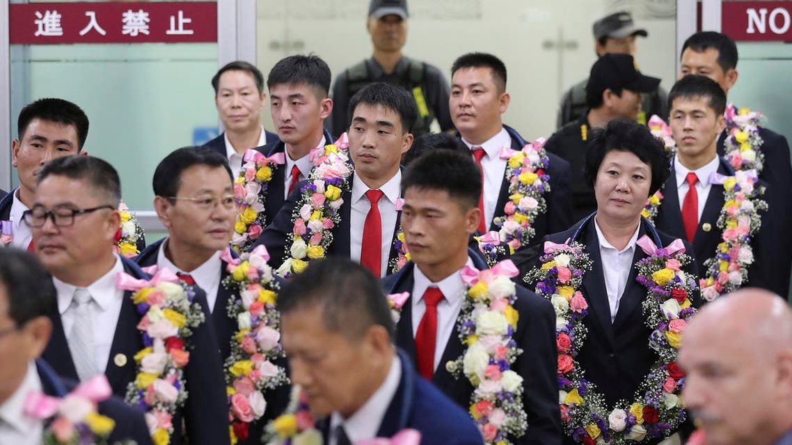 In this June 23, 2017 file photo, North Korean taekwondo demonstration team members and other officials arrive at Gimpo International Airport in Seoul, South Korea. (AP)