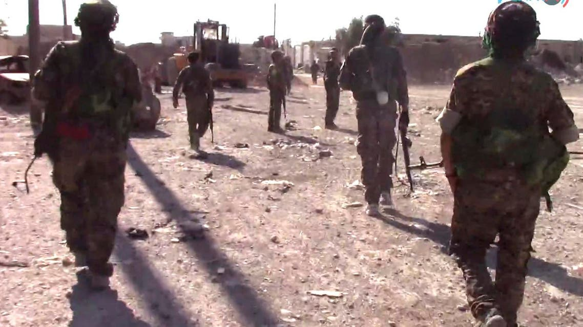 This frame grab from video released  on Friday, Aug. 11, 2017 by Furat FM, shows US-backed Syrian Democratic Forces (SDF) fighters advance in Raqqa, Syria. (AP)