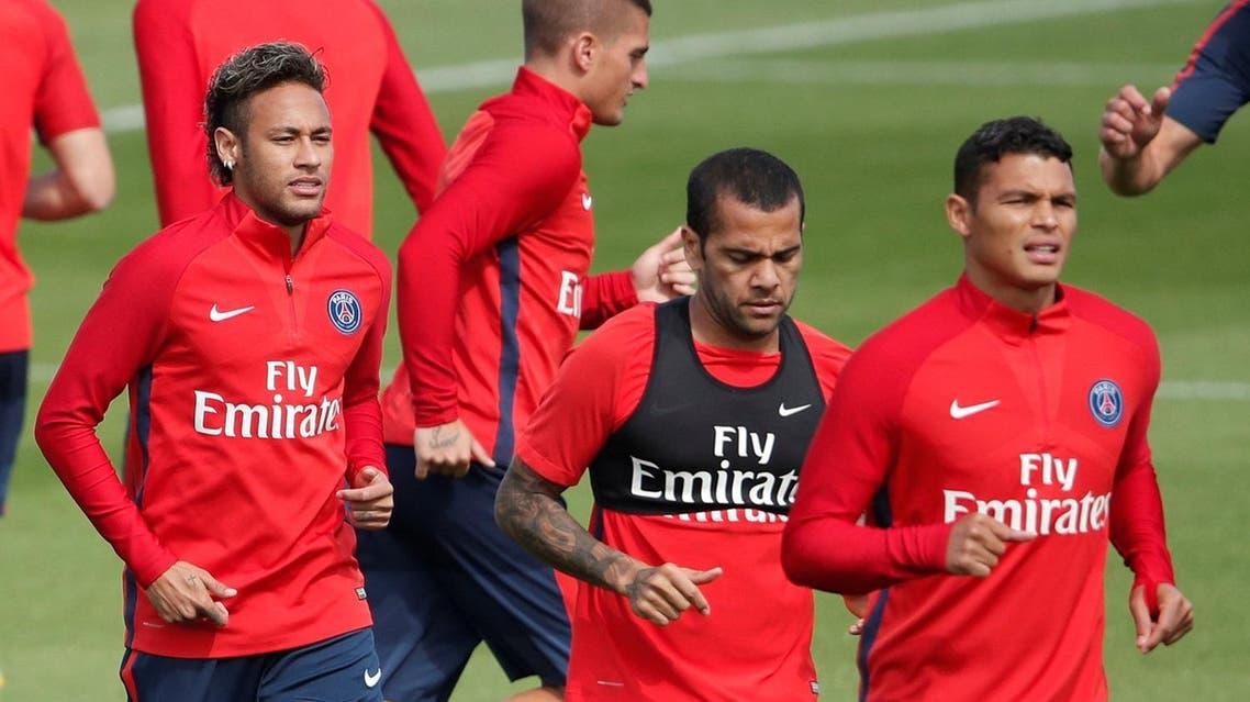 PSG's Neymar (left), Dani Alves and Thiago Silva during training at the Ooredoo camp, Saint-Germain-en-Laye near Paris, France, on August 11, 2017. (Reuters)