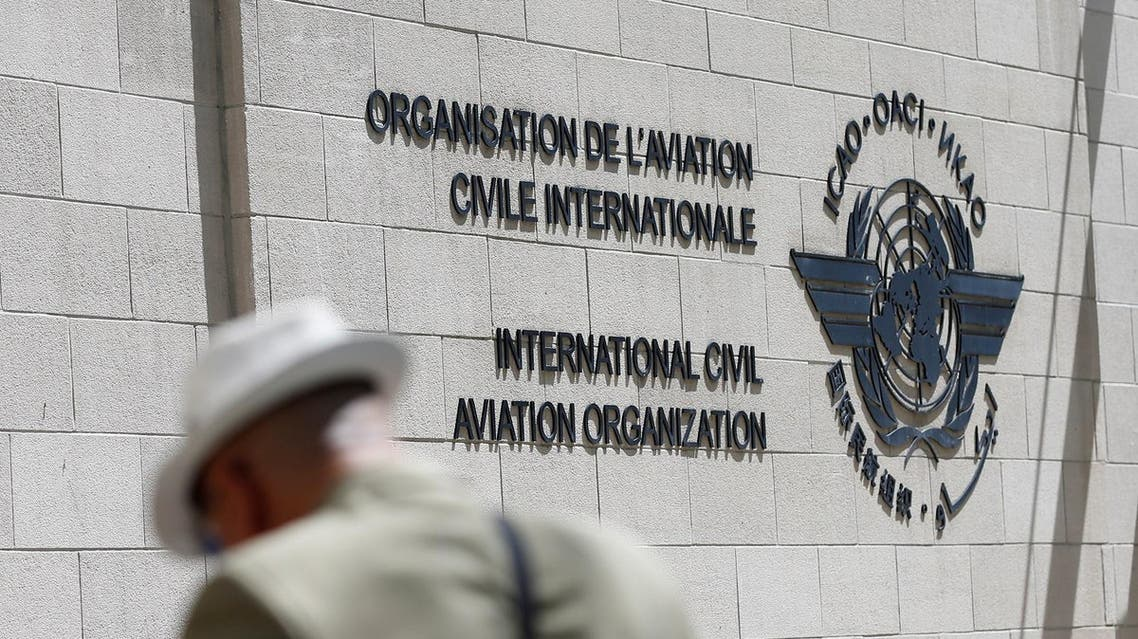 A man eats lunch outside the International Civil Aviation Organization (ICAO) headquarters building is in Montreal, Quebec, Canada June 15, 2017. REUTERS/Christinne Muschi