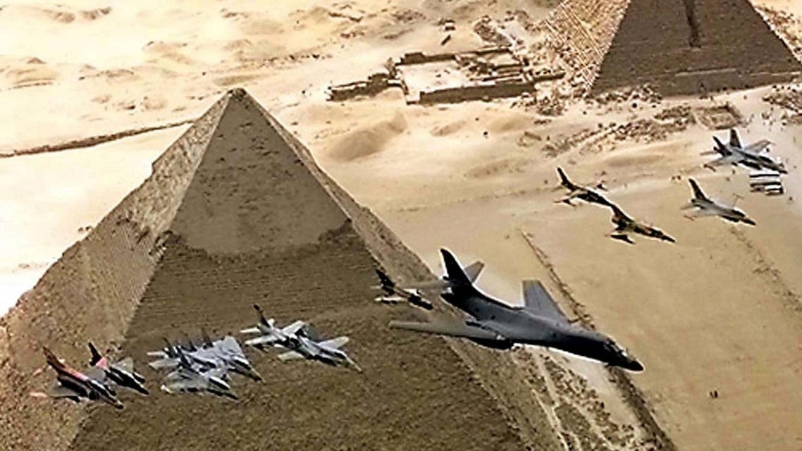 Fighter aircraft, led by a USAF B1-B tactical bomber, fly over the 4,500-year-old pyramids October 25 during the Bright Star 99 manoeuvres. (Reuters)