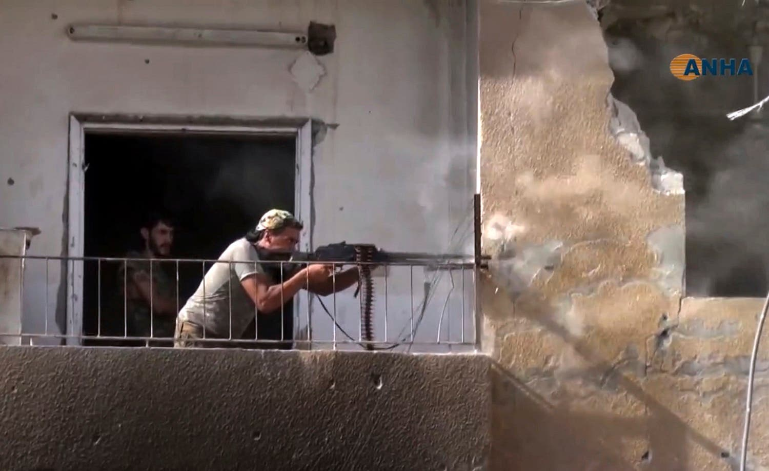 This frame grab from video released  onThursday, Aug. 3, 2017 and provided by Hawar News Agency, shows a fighter from the US-backed Syrian Democratic Forces (SDF) firing his weapon during clashes with ISIS group fighters in the northern city of Raqqa, Syria. (AP)