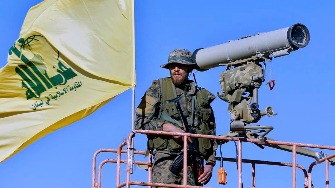 A Hezbollah fighter stands at a watchtower at the site where clashes erupted between Hezbollah and al-Qaeda-linked fighters in Wadi al-Kheil or al-Kheil Valley in the Lebanon-Syria border. (AP)