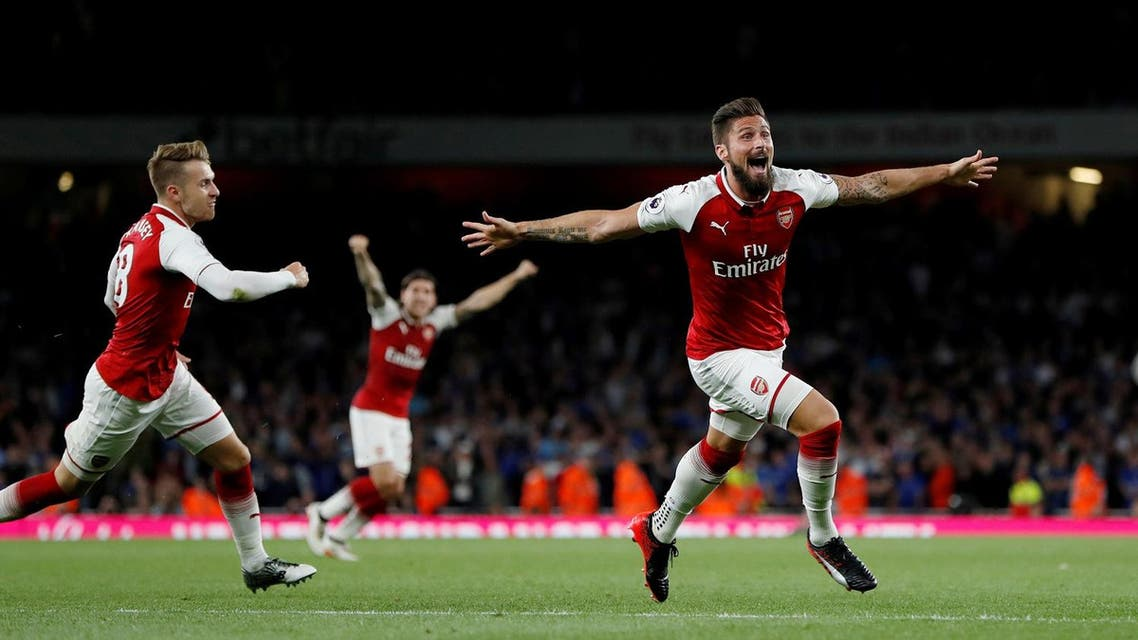 Arsenal's Olivier Giroud celebrates scoring their fourth goal against Leicester City with Aaron Ramsey on Friday, August 11, 2017. (Reuters)
