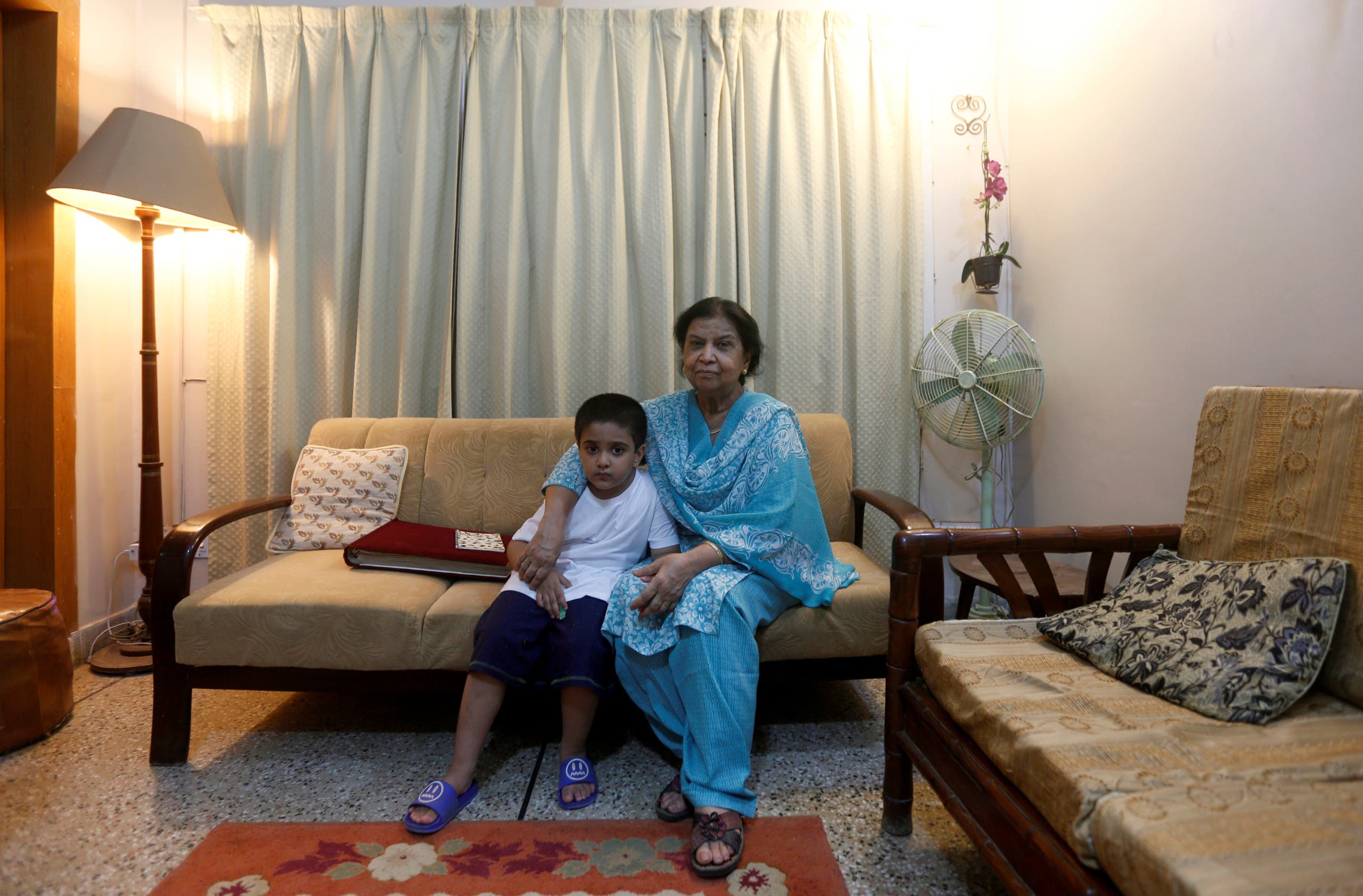 Rehana Khursheed Hashmi, 75, migrated from India with her family in 1960 and whose relatives, live in India, sits with her five year-old grandson Faraz Hashmi, at her residence in Karachi, Pakistan August 7, 2017. (Reuters)