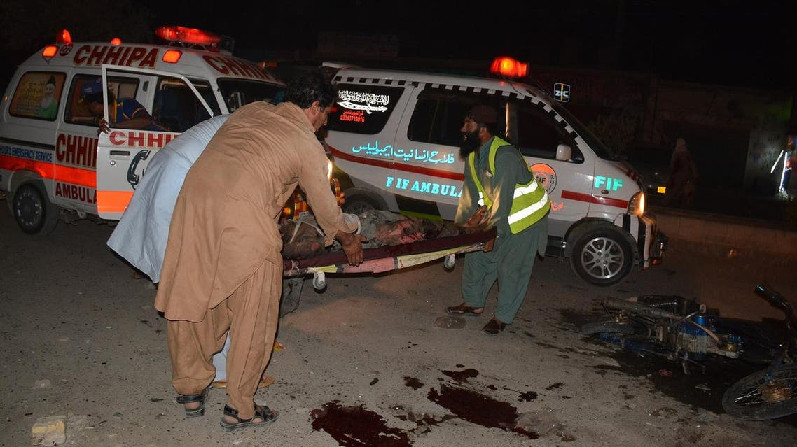 Pakistani soldiers and volunteers use a stretcher to move a victim's body after a blast in Quetta on August 12, 2017. (AFP)