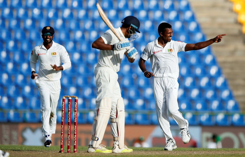 Sri Lanka's Vishwa Fernando celebrates after taking the wicket of India's Ravichandran Ashwin. (Reuters)
