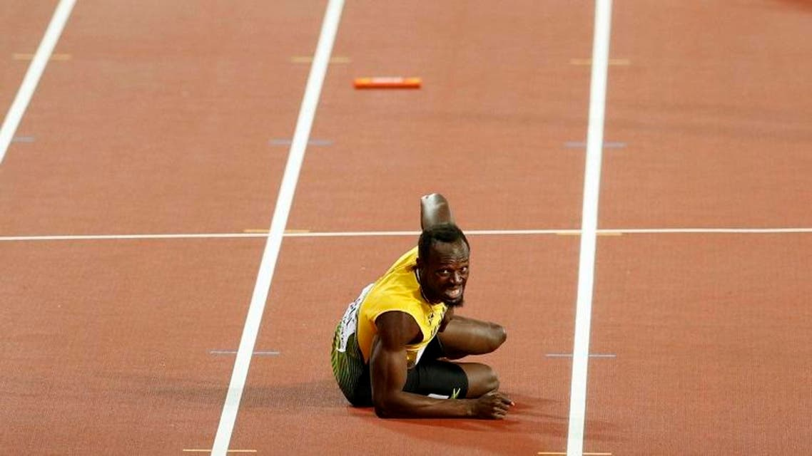 Usain Bolt of Jamaica reacts after the final. (Reuters)