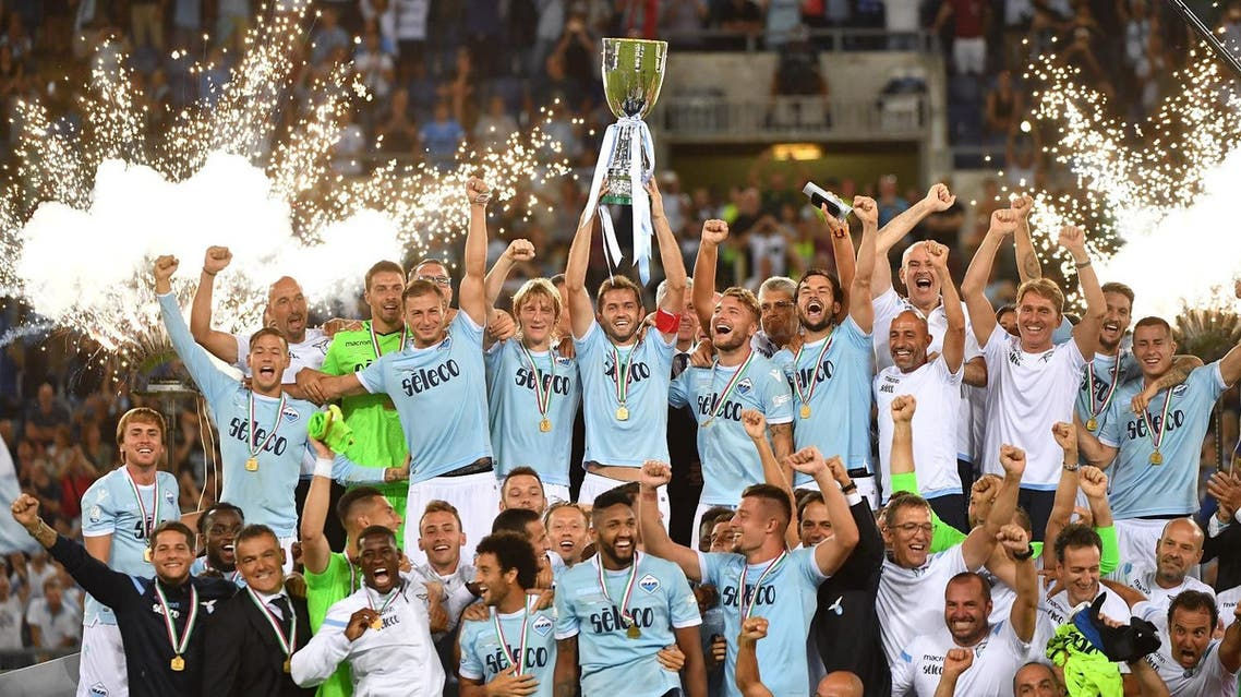 Lazio's players celebrate with the trophy after winning the Italian SuperCup TIM football match Juventus vs lazio on August 13, 2017 at the Olympic stadium in Rome. AFP