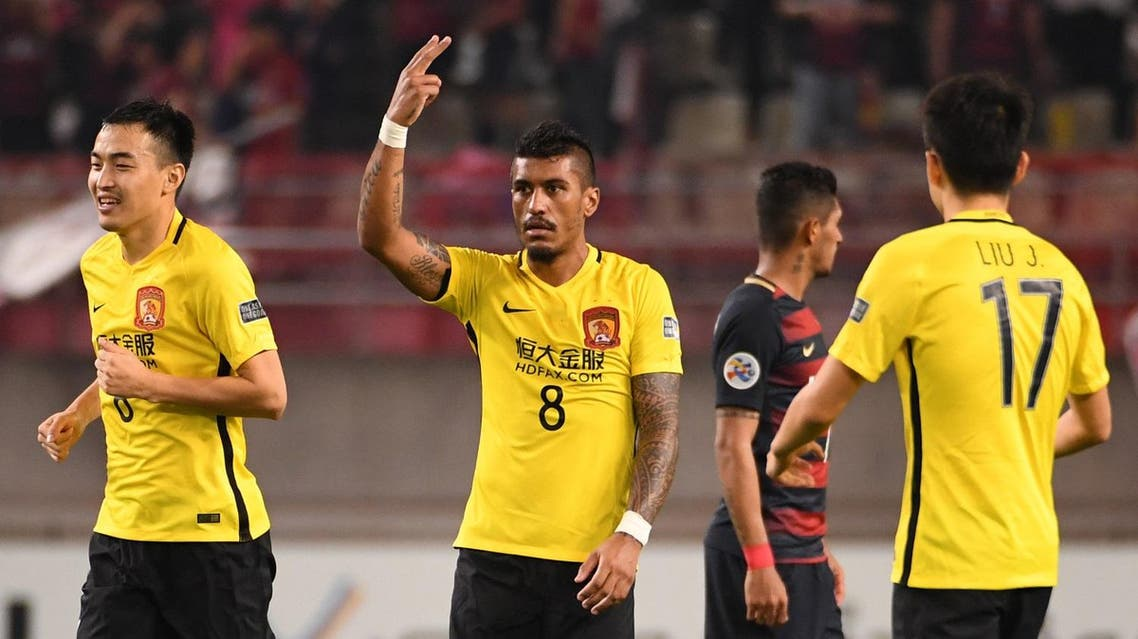 (FILES) This file picture taken on May 30, 2017 shows Guangzhou Evergrande's midfielder Paulinho (C) celebrating his goal during the AFC Champions League football match between Japan's Kashima Antlers and China's Guangzhou Evergrande in Kashima, Ibaraki prefecture. Brazil international Paulinho's imminent move to Barcelona from Guangzhou Evergrande is proof of the strength of the Chinese Super League (CSL), Shanghai SIPG coach Andre Villas-Boas said. The 29-year-old midfielder Paulinho is reportedly poised to sign for the Spanish giants for 40 million euros and he could be unveiled as a Barcelona player as early as August 14, 2017. (AFP)