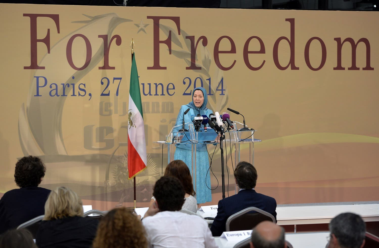 Maryam Rajavi, (C) founder of the People's Mojahedin Organization of Iran (PMOI) and president of the National Council of Resistance of Iran (NCRI) speaks on June 27, 2014 in Villepinte. (AFP)